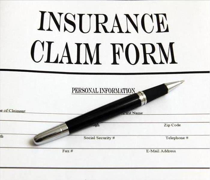 Clip art shows insurance claim form and pen.